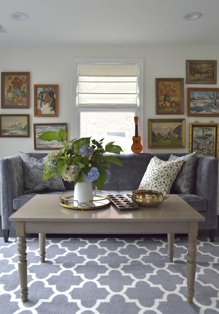 Vintage paint by numbers art; living room; coffee table; rug; sofa | Image source: Design Sponge