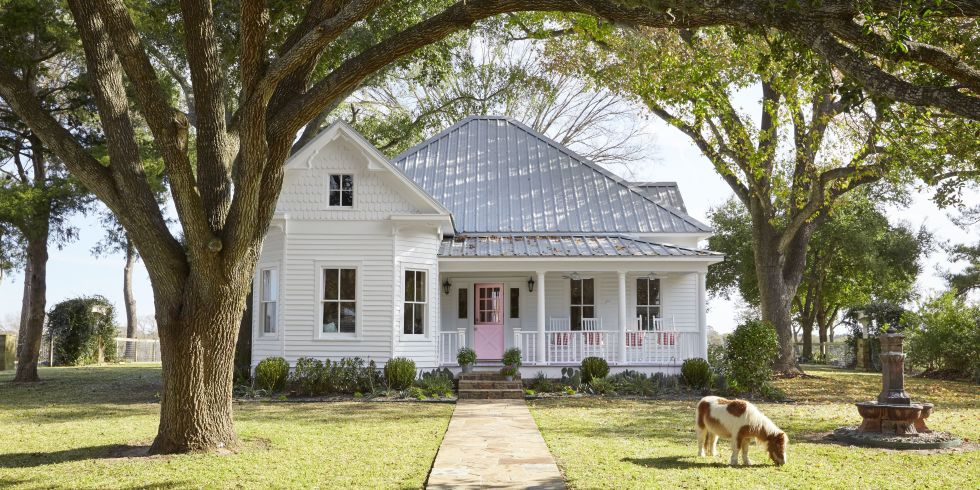 MUST-SEE: Inside a 105-Year-Old Victorian Farmhouse in Texas >  http://www.countryliving.com/home-design/house-tours/g2233/bailey-mccarthy-texas-farmhouse/?   —  What a great Texas farmhouse we have here. It's located  in the rolling hills, just east of us here in Houston. I love the kitchen. (Hmmmm, another black kitchen; I must be craving these for some reason!) I love how they painted the cabinets the same color as the walls to blend everything in, as well as how they made those ceilings soar.  | Interior Designer: Bailey Mccarthy