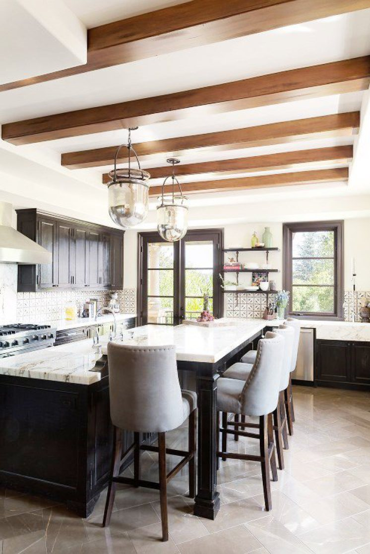 MUST-SEE: A Rustic Kitchen, Canyon Style >  http://cococozy.com/2015/05/rustic-kitchen-canyon-style.html   — Here's an interesting kitchen I found while trolling the internet. I love the rustic black painted wood, and the tile, too. It's a bright kitchen even though all the cabinets are black. Love!   | Interior Designer: Ryan Brown