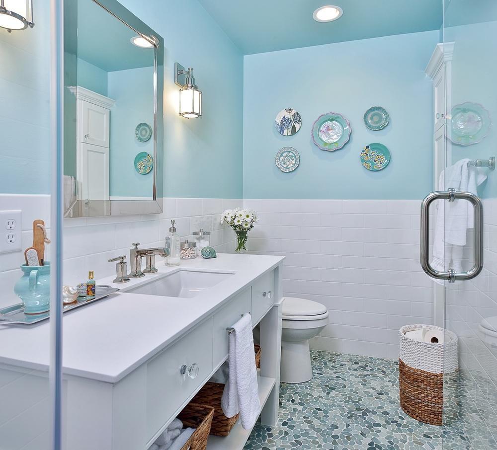 Bathroom; mosaic tile; toilet; sink; mirror; shower   Interior Designer: Carla Aston