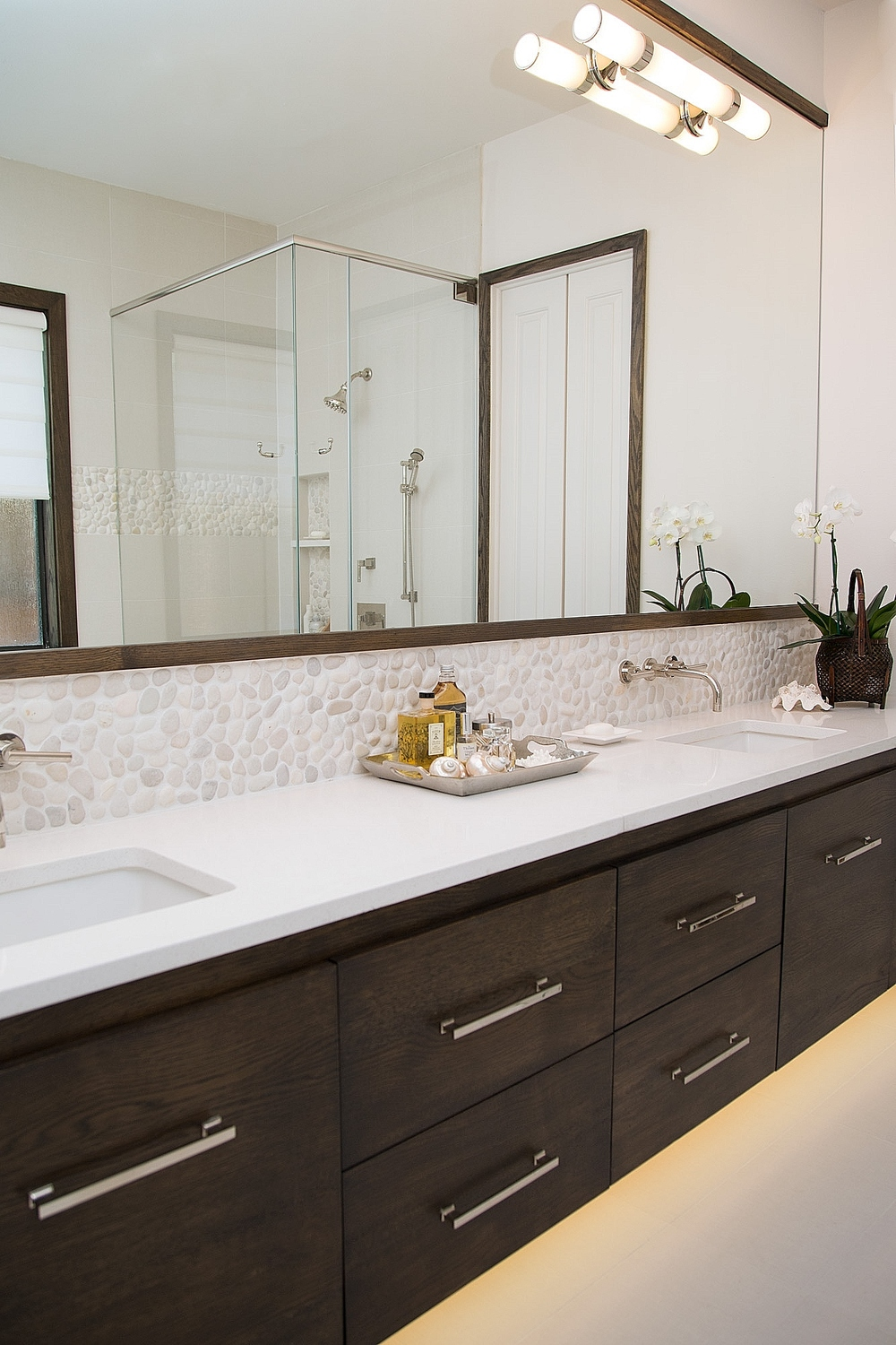 Master Bath Remodel - floating cabinetry, pebble tile backsplash, wall mount faucets