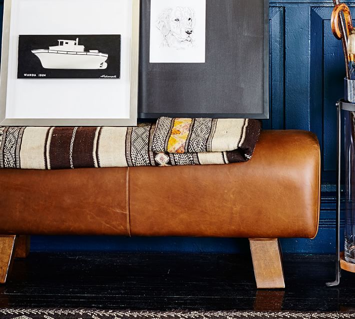 Ken Fulk leather pommel bench; framed art | Image source: Pottery Barn
