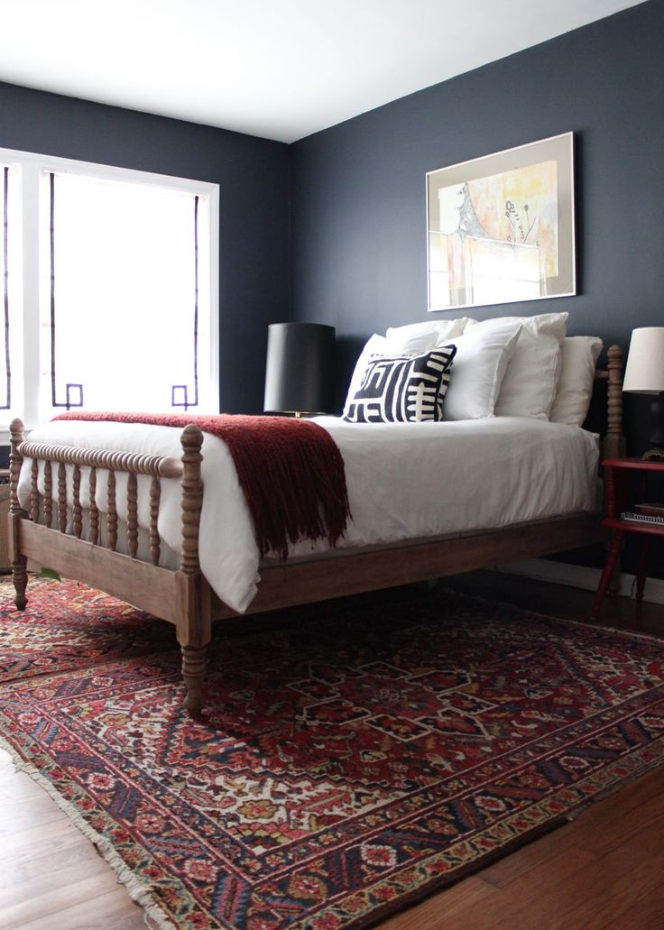 bedroom; white bedding; rug; lamp | Image source: The Nesting Game Blog