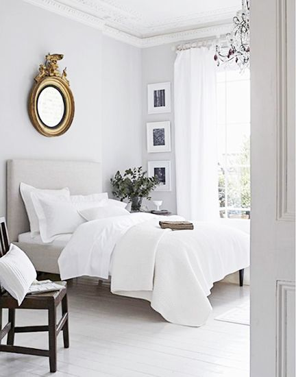White bedroom; bed; bedding; mirror; chair | Stylist: Elkie Brown / Image source: Domaine Home
