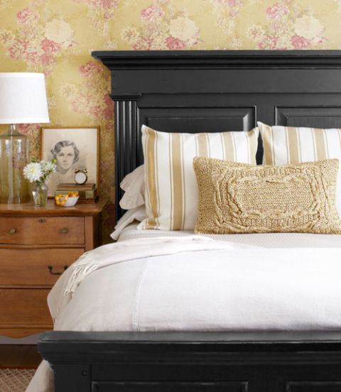 Bedroom; white bedding; headboard; lamp | Image source: Country Living