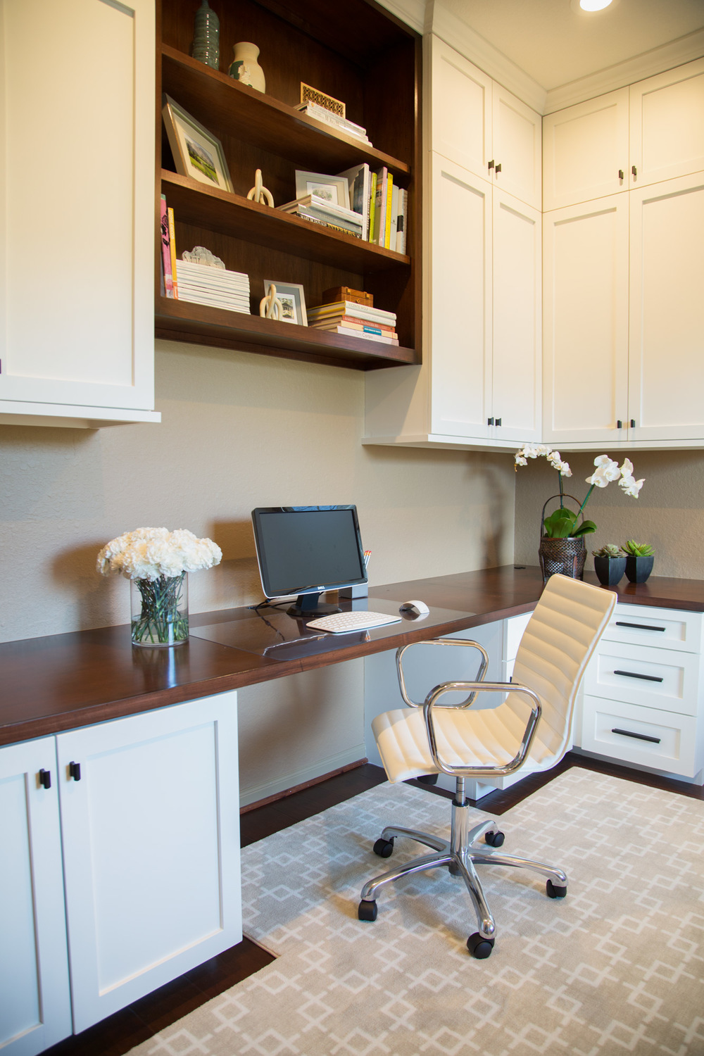 Home office remodel; desk; chair; rug; cabinetry; bookshelf decor | Interior Designer: Carla Aston /  Photography by Tori Aston