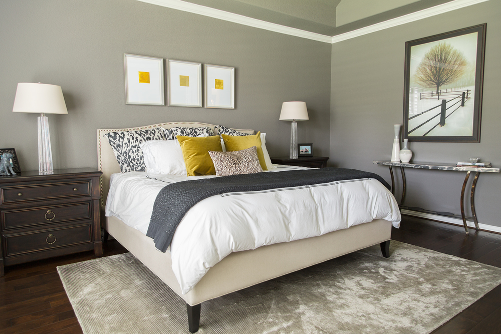 Bedroom remodel; bed; bedding; rug; lamp; lighting; mirror; table | Interior Designer: Carla Aston / Photographer: Tori Aston