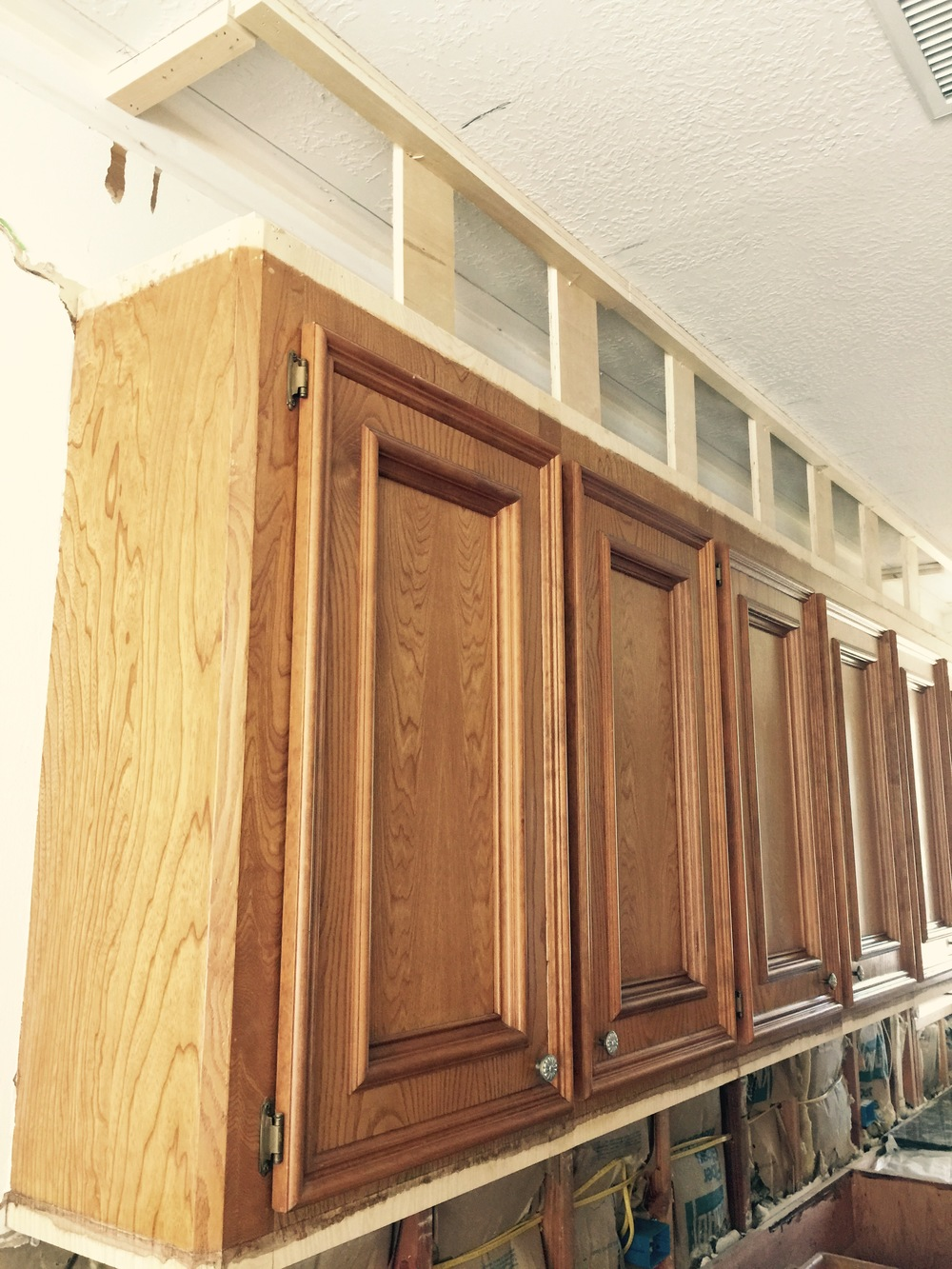 Before after a dark dismal kitchen is made light and for Bulkhead above kitchen cabinets