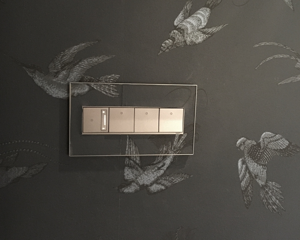 Legrand Adorne switches on wallpaper