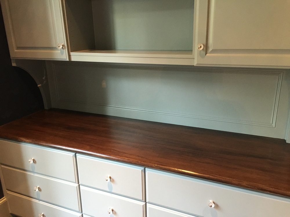 Faux finish wood top adds quality and upgrades the look of this built-in cabinet - done by Luis Altamirano of Transformations by Phyllis
