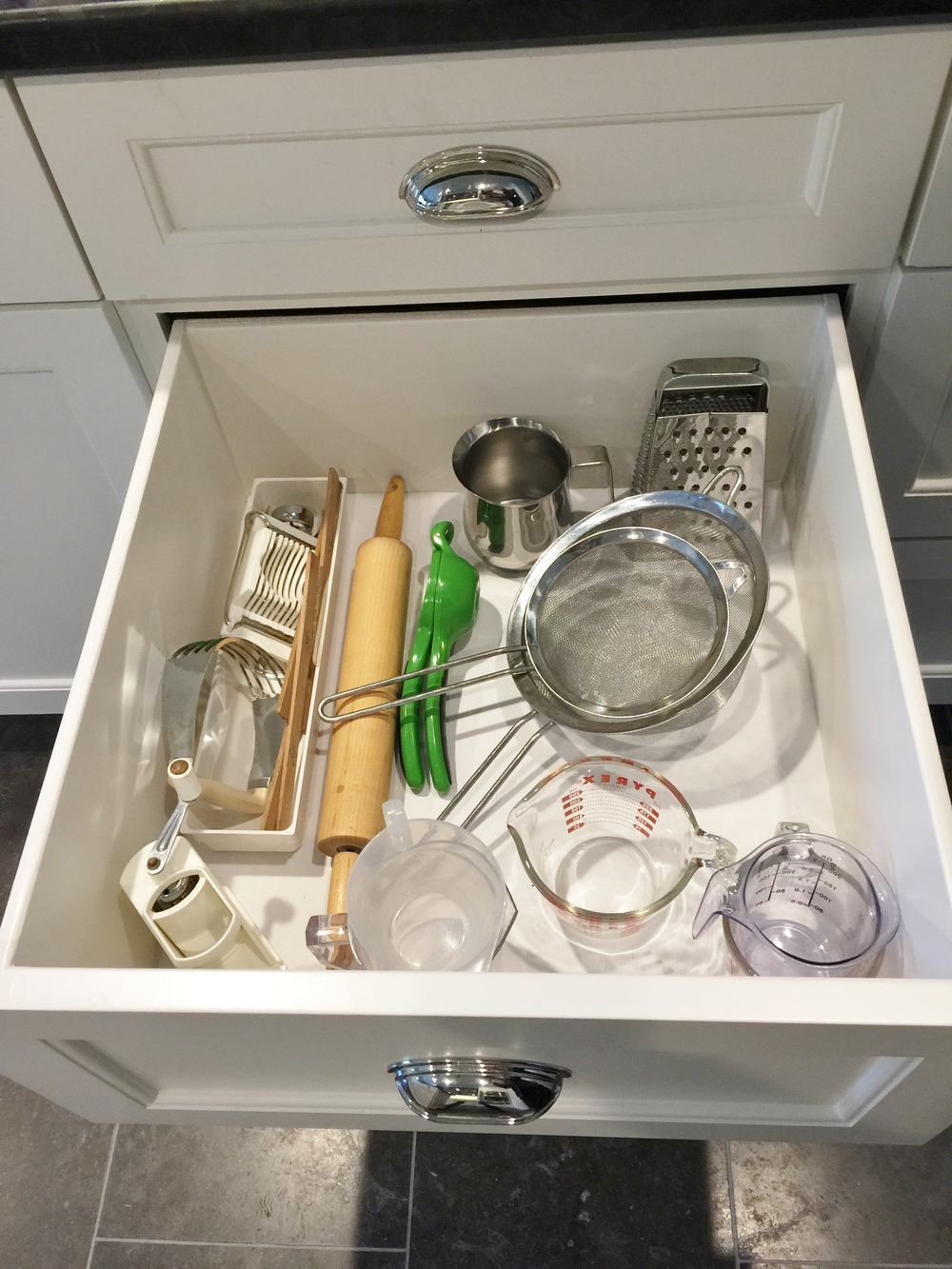 Wide deep drawer open with kitchen tools | interior Designer: Carla Aston