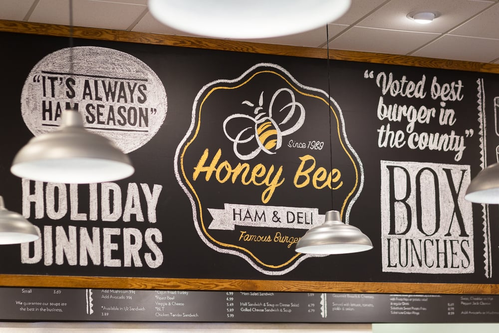 Before & After: A Honey Bee Ham restaurant remodel | Cafe - Deli counter and signage | Interior Designer: Carla Aston / Photographer: Tori Aston