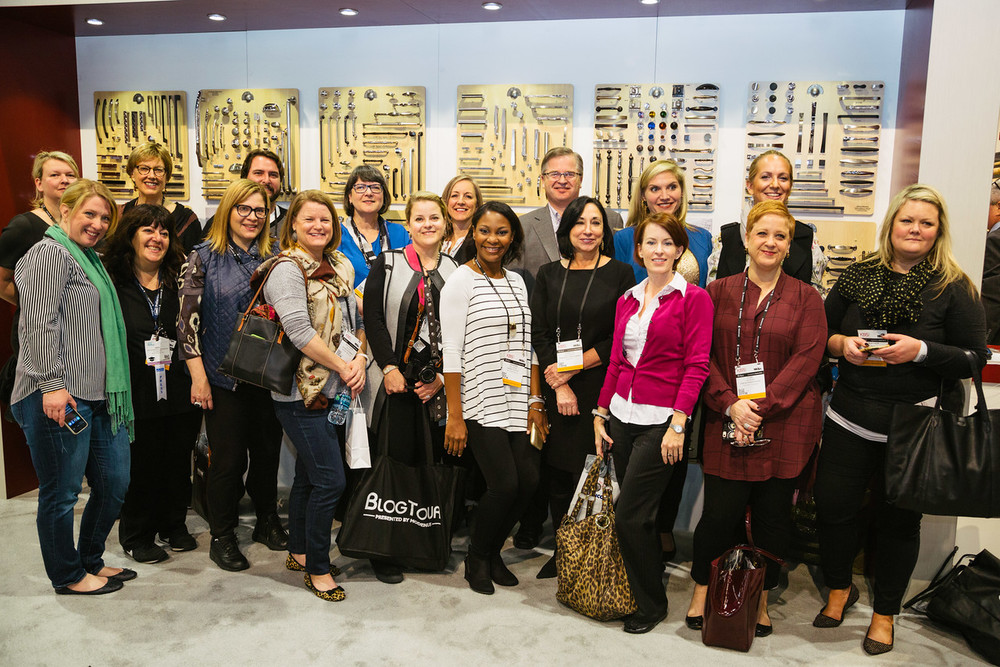 Here are most of us in the Top Knobs booth getting our hands on all their wonderful hardware. (That's the BEST way to see hardware BTW.) Image via: Modenus, Photographer: Tori Aston