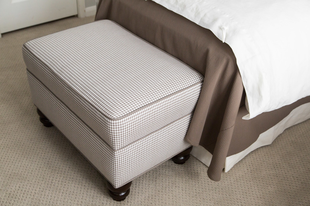 Custom ottoman with contrasting welting, Designer: Carla Aston