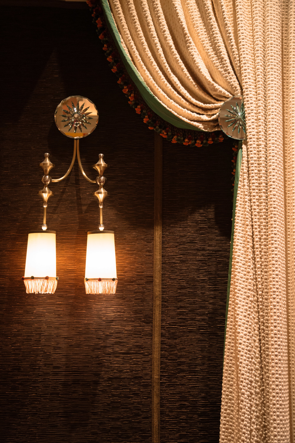 Wynn Hotel's wedding venue, wall sconces, fringe, tassles, drapery, wall upholstery, tiebacks, details | Photographer: Tori Aston