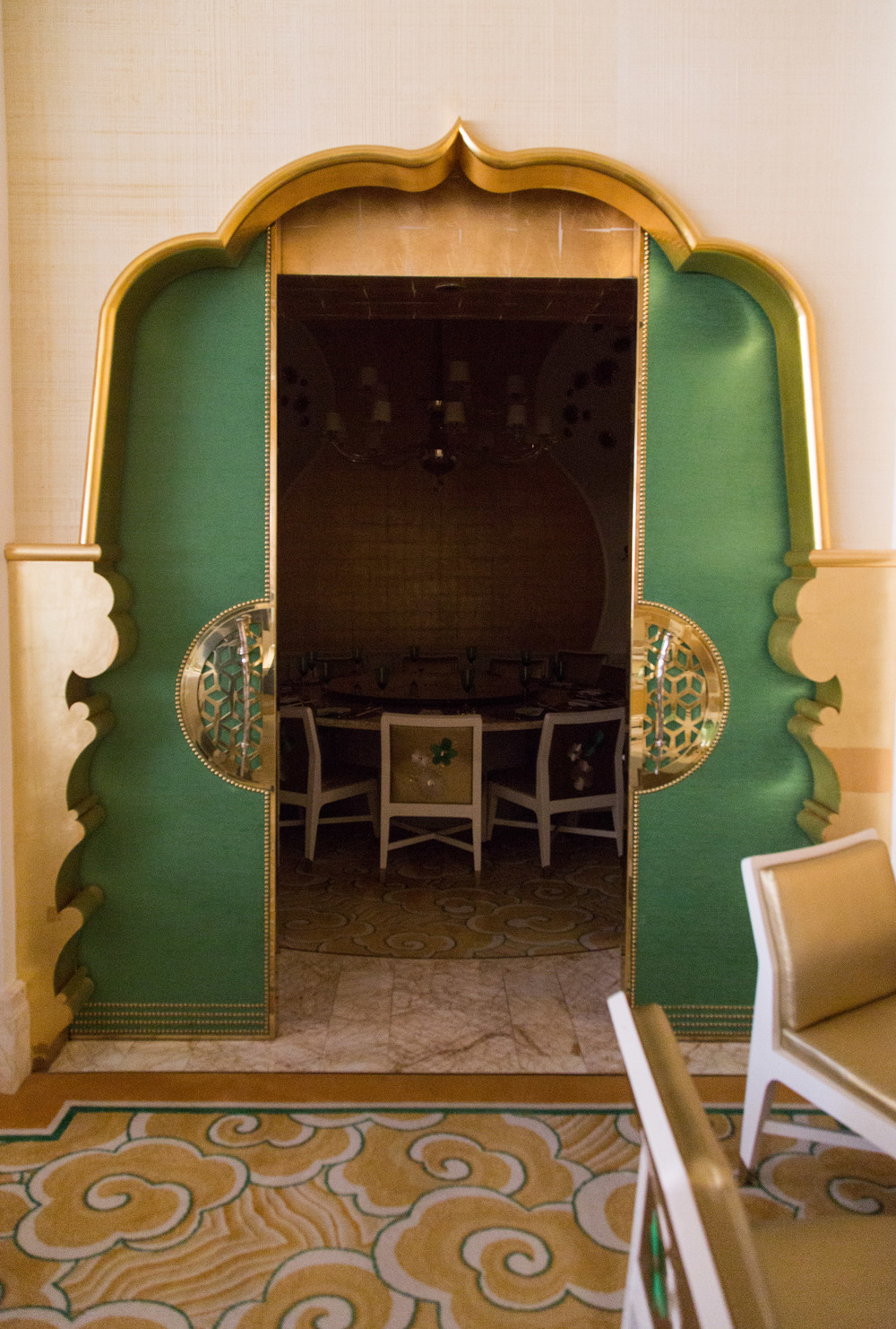 Wynn Hotel restaurant, green and gold, doors, Asian style | Photographer: Tori Aston