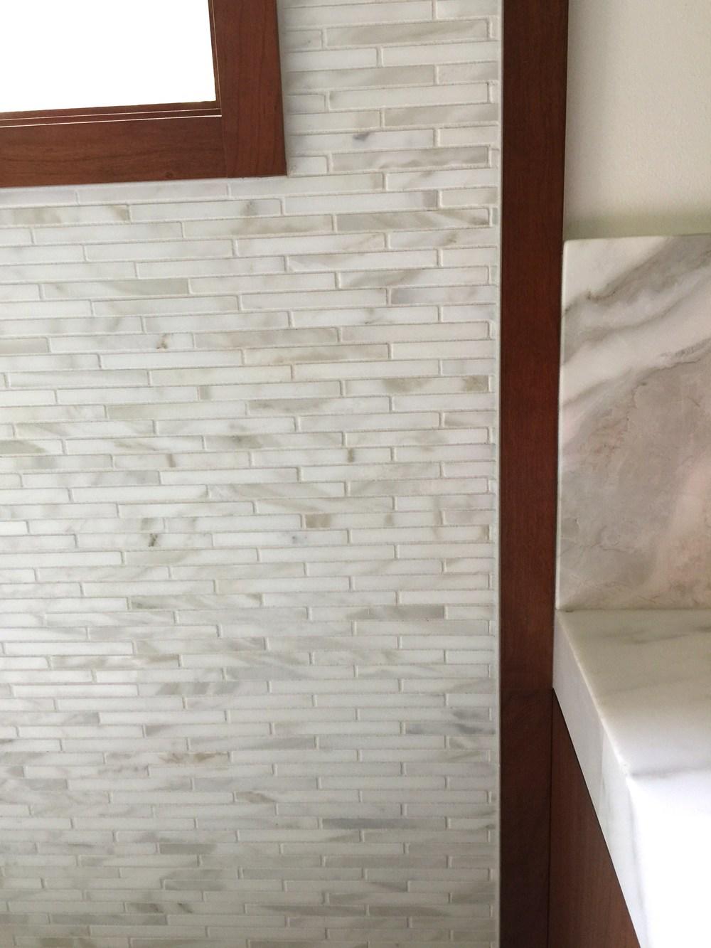Master Bath Calacatta marble tile and wood trim detail | Interior Designer: Carla Aston