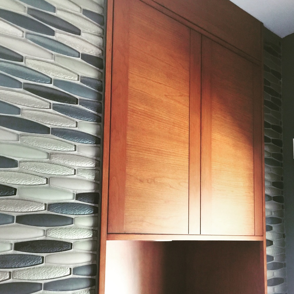 Pool Bath Detail - contemporary orange toned wood cabinetry and gray wall tile | Interior Designer: Carla Aston