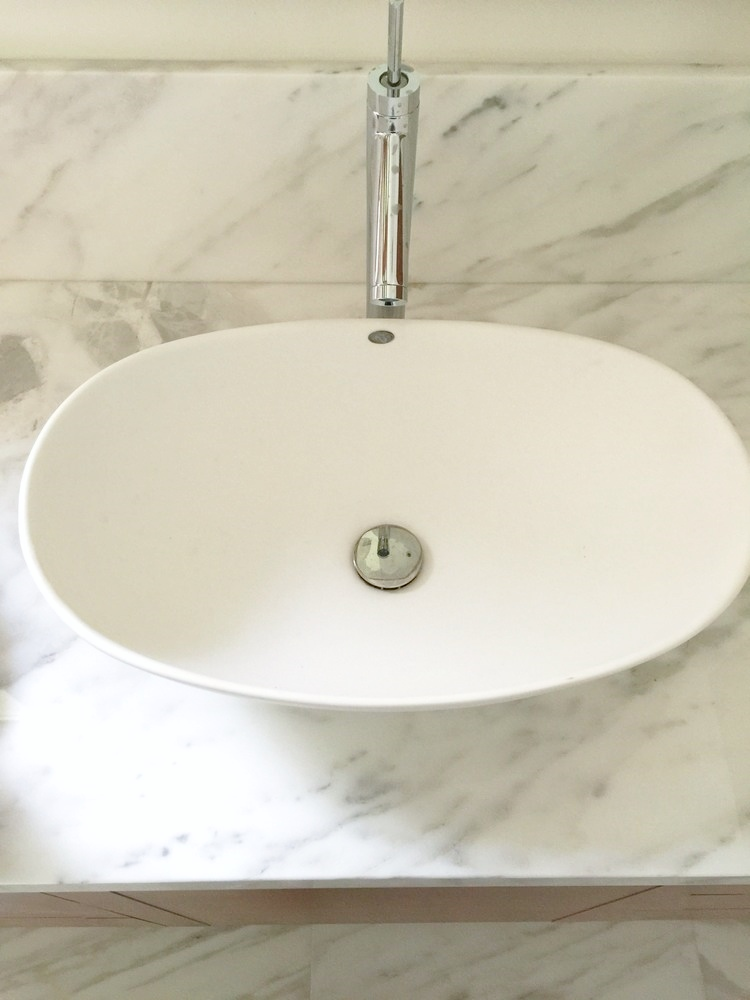 Master Bath vessel sink with Calacatta marble | Interior Designer: Carla Aston