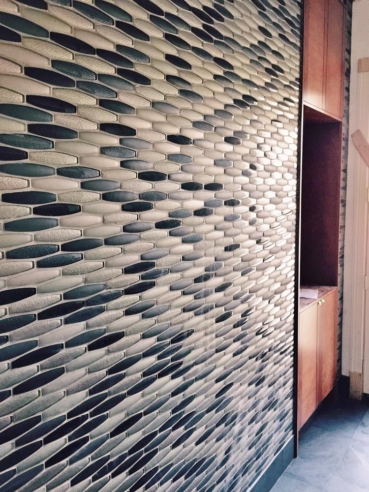 Pool Bath - during construction w/ orange tone contemporary wood cabinetry | Interior Designer: Carla Aston