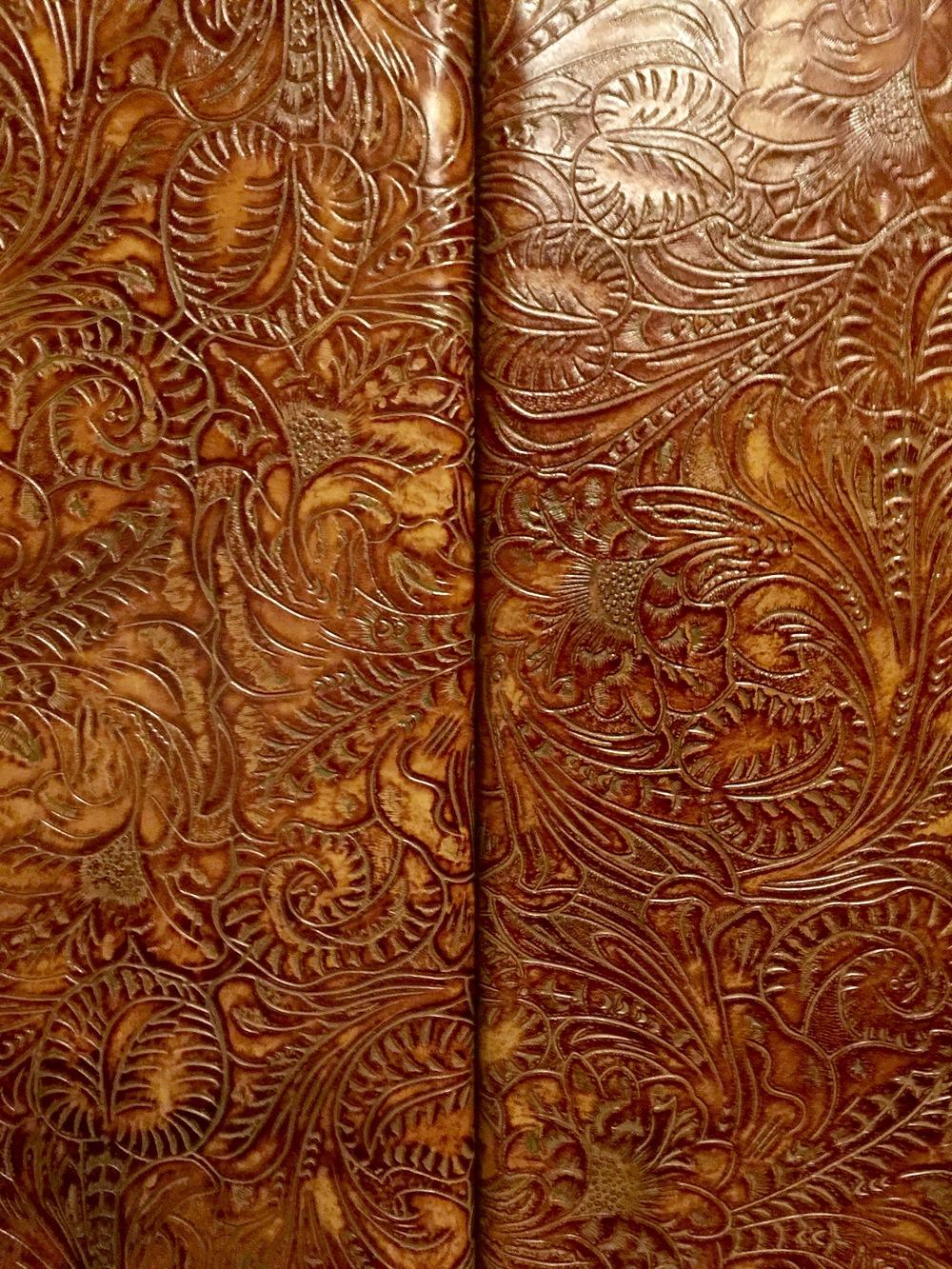 Tooled leather panels - Hotel Emma elevator cab