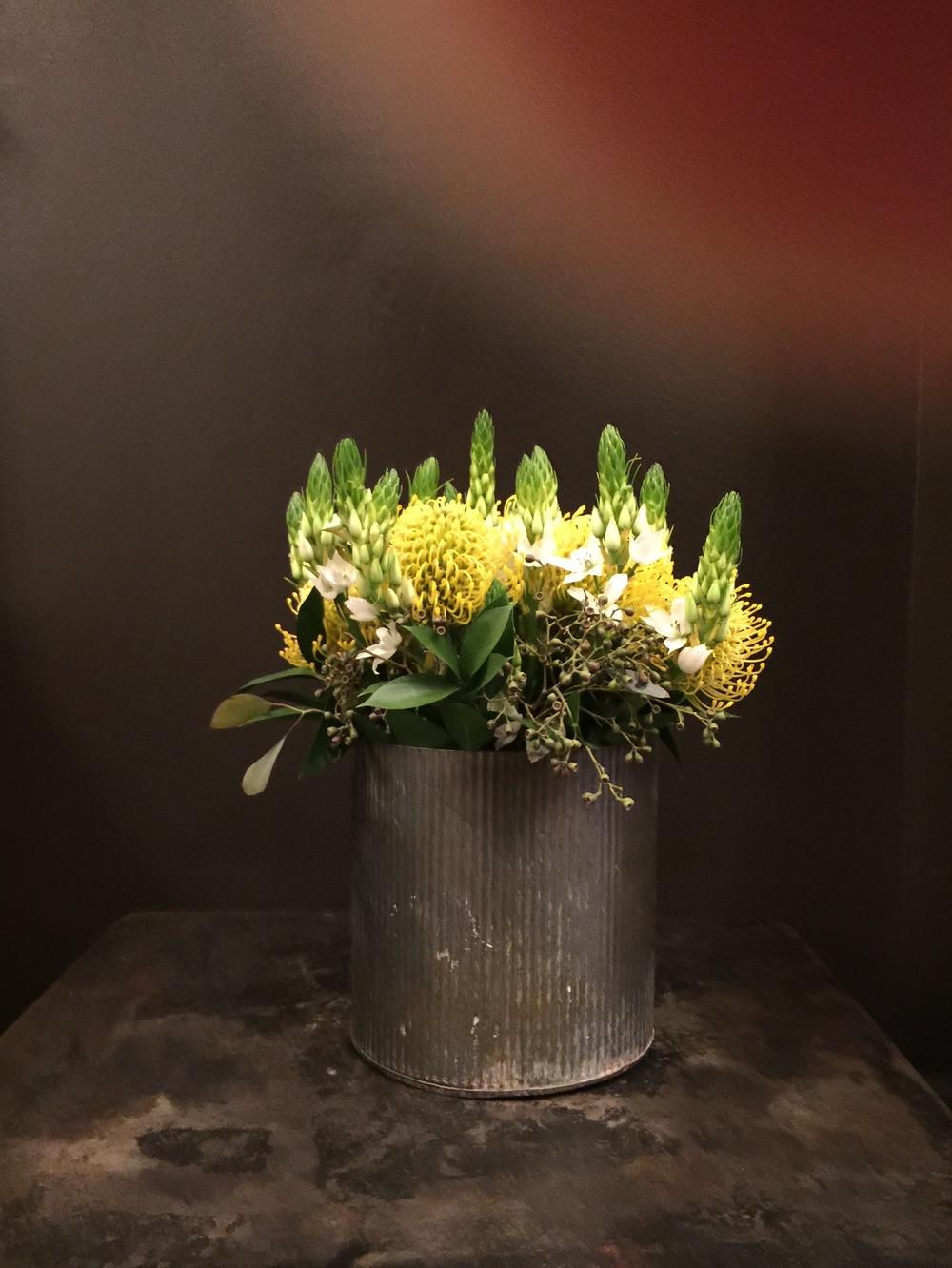 Fresh flowers in metal can - Hotel Emma