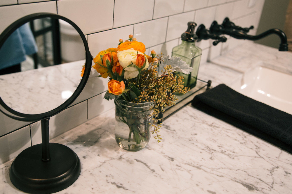 Bathroom styling, white marble, wall mount faucet, subway tile | Interior Designer: Bobby Berk