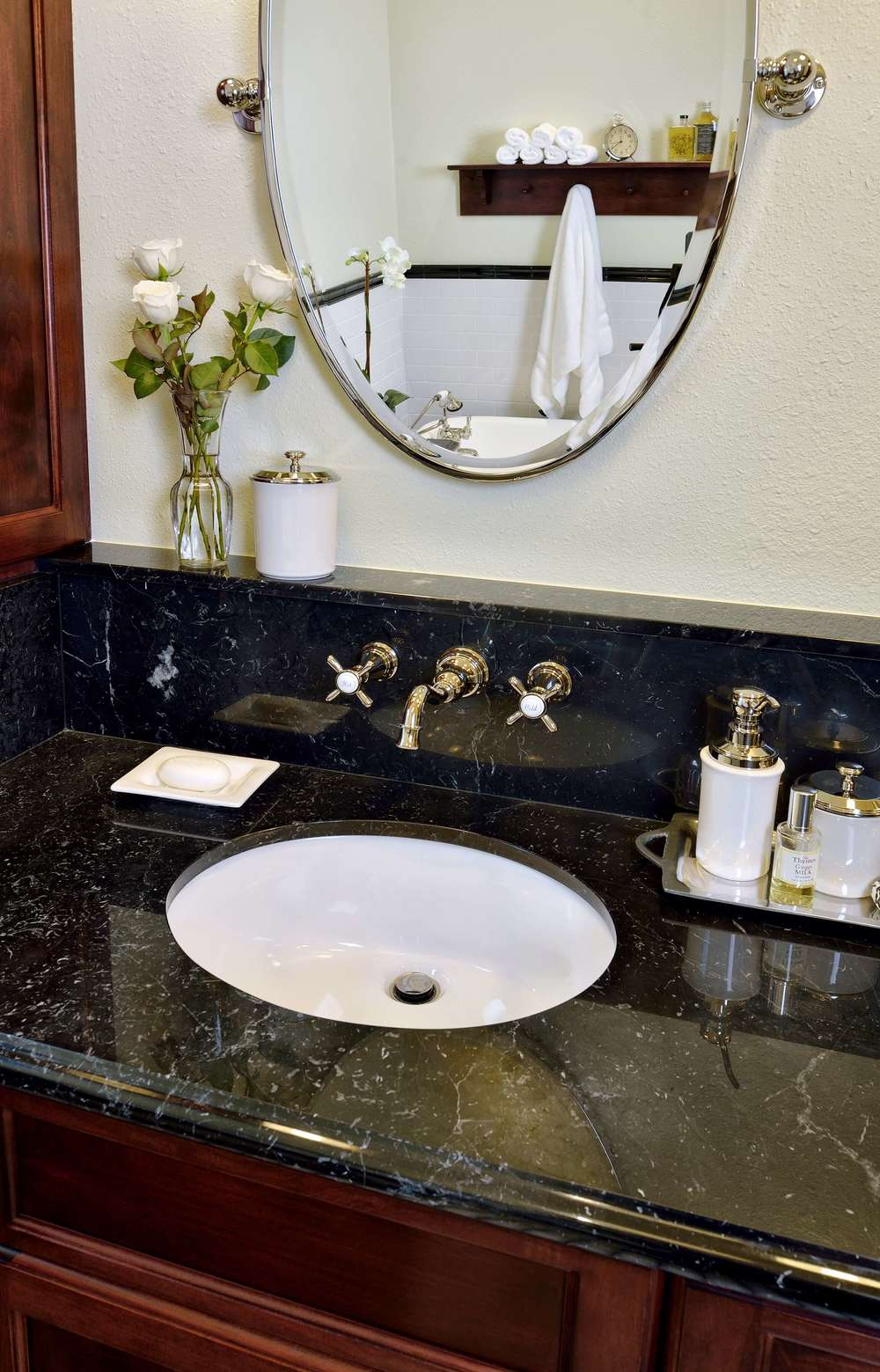 wall mount faucet with ledge at bathroom sink in bathroom remodel, Designer: Carla Aston