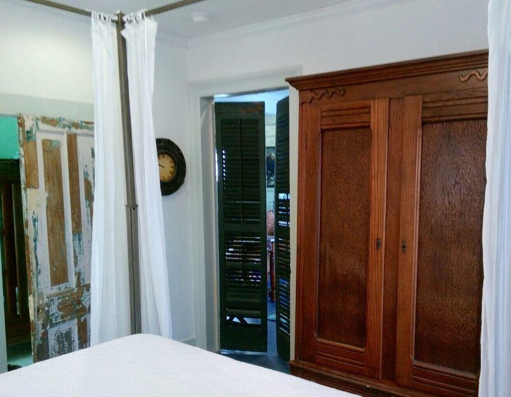 Bedroom antique armoire - The house has no closet!