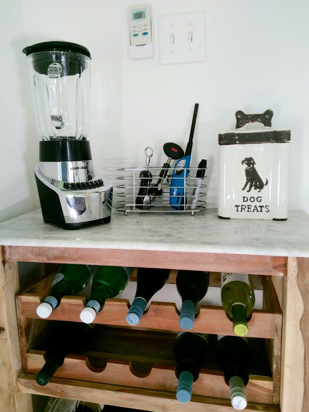 Kitchen Wine Rack - Dog treat container found at a shop, Modern Vintage, on the island.