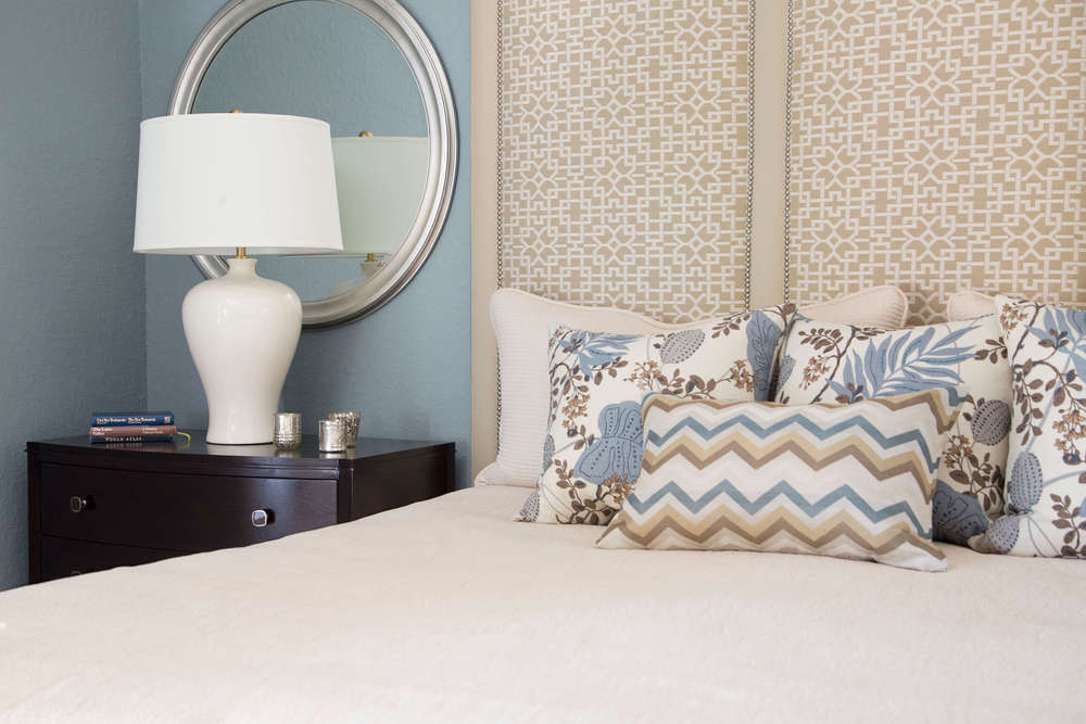 Bedroom - bed, pillows, lamp, mirror   Interior Designer: Carla Aston
