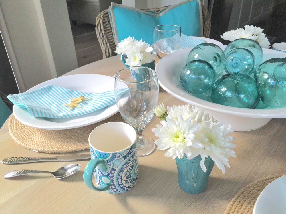 Coastal tabletop, beach inspired entertaining, turquoise and white, glass floats | Interior Designer: Carla Aston