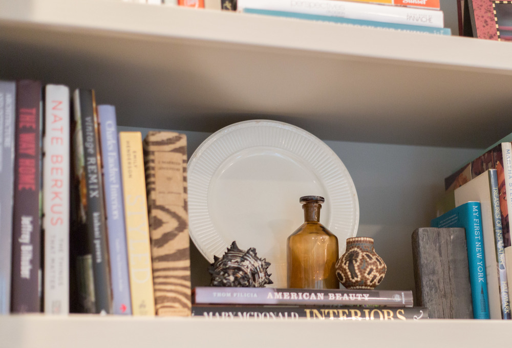 Plate on a bookshelf, Tori Aston, photographer