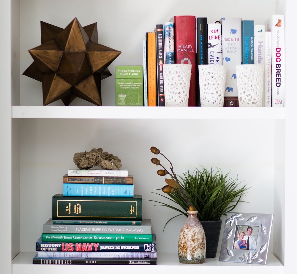 Bookshelf styling - The coppery Moravian star, small vase and pot of greens from At Home fill out the bookcases nicely.