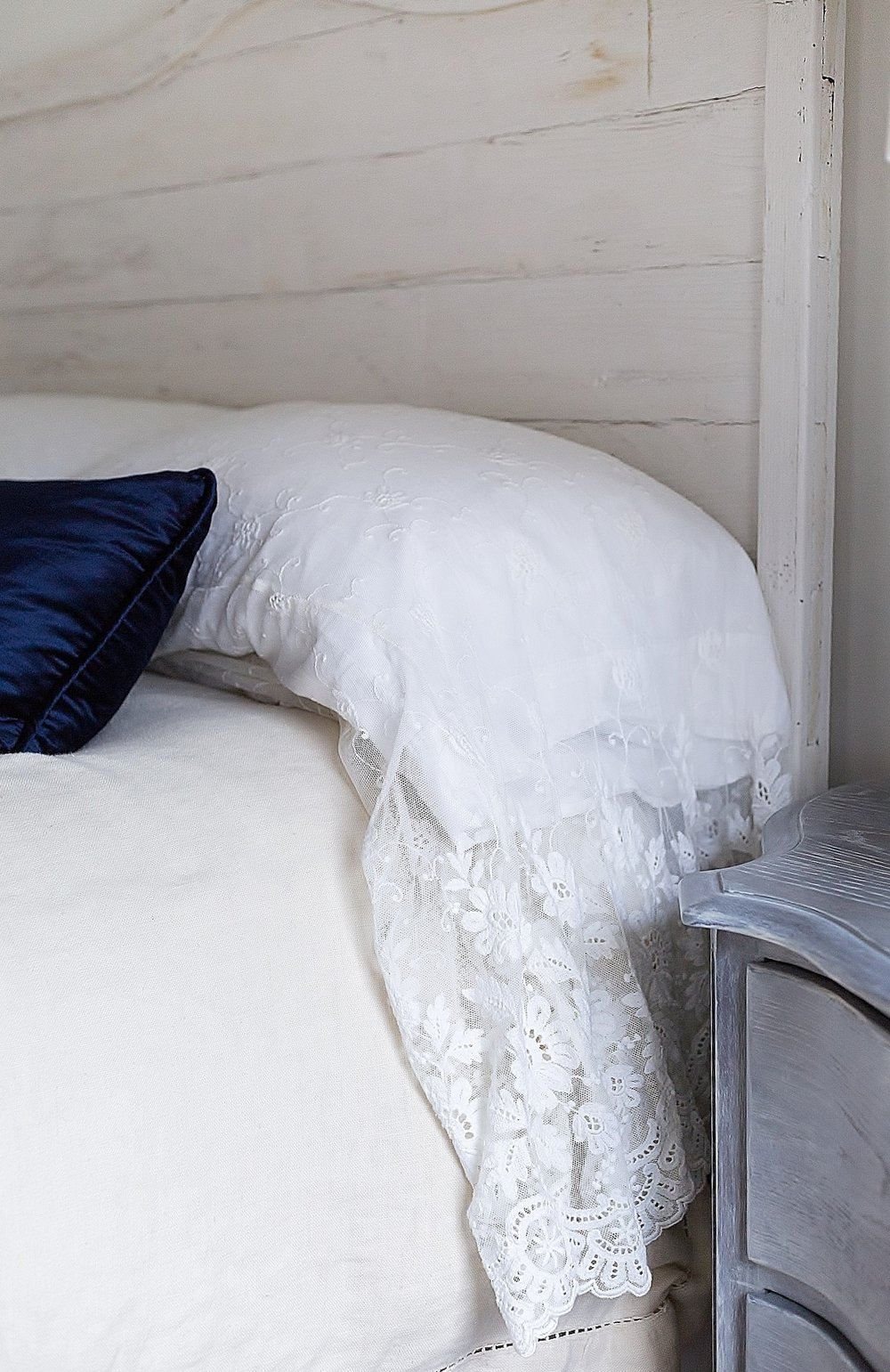 Lace pillowcase with linen bedding and velvet pillow