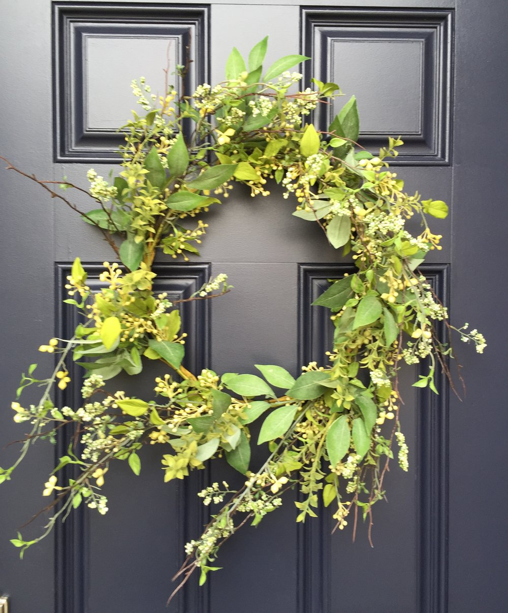 Navy front door with wreath