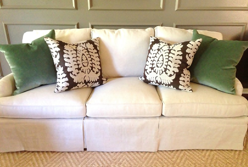 Velvet and patterned pillows on neutral sofa - Designer, Carla Aston