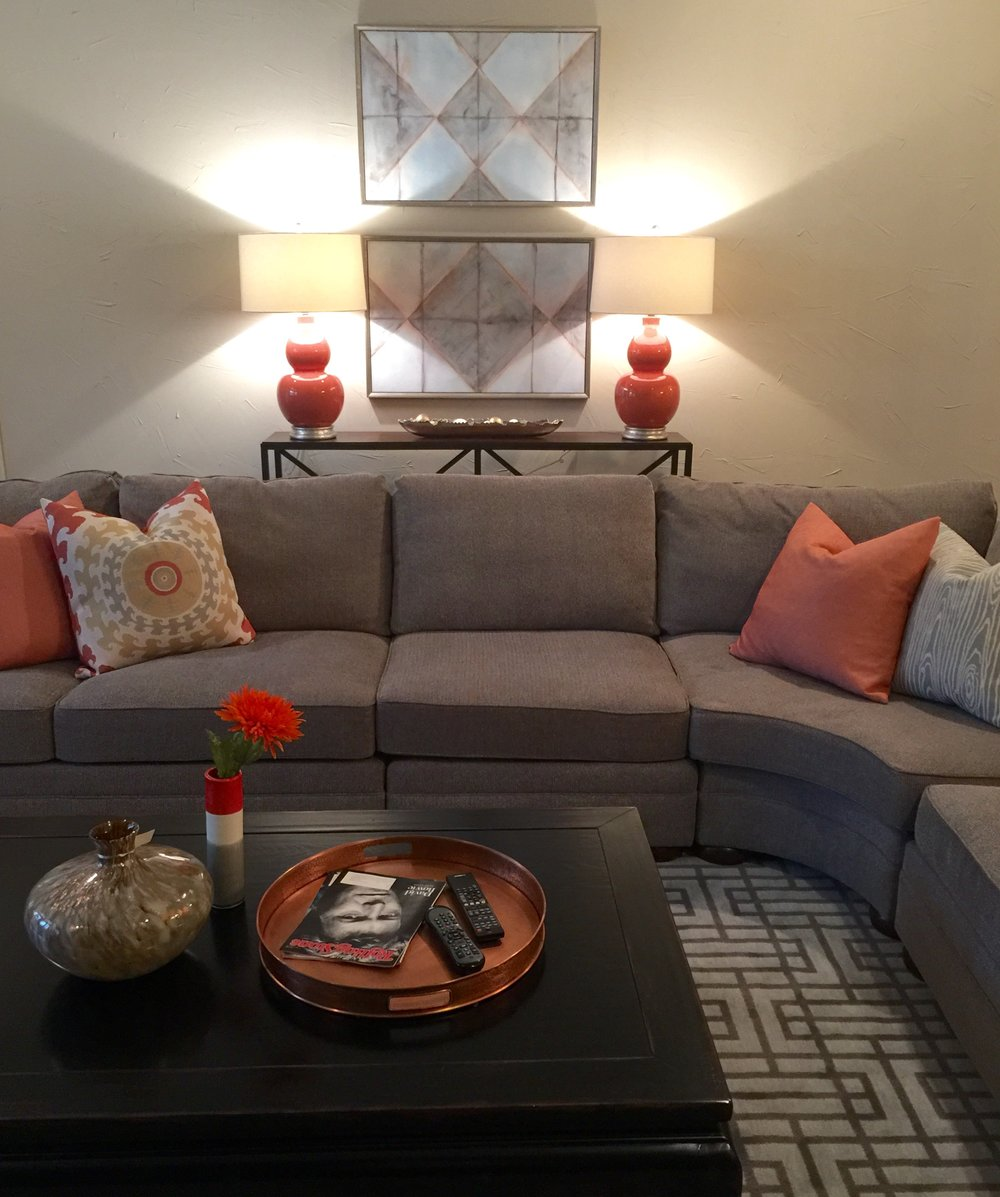 Gray sectional with colorful pillows and accents - Carla Aston: Designer