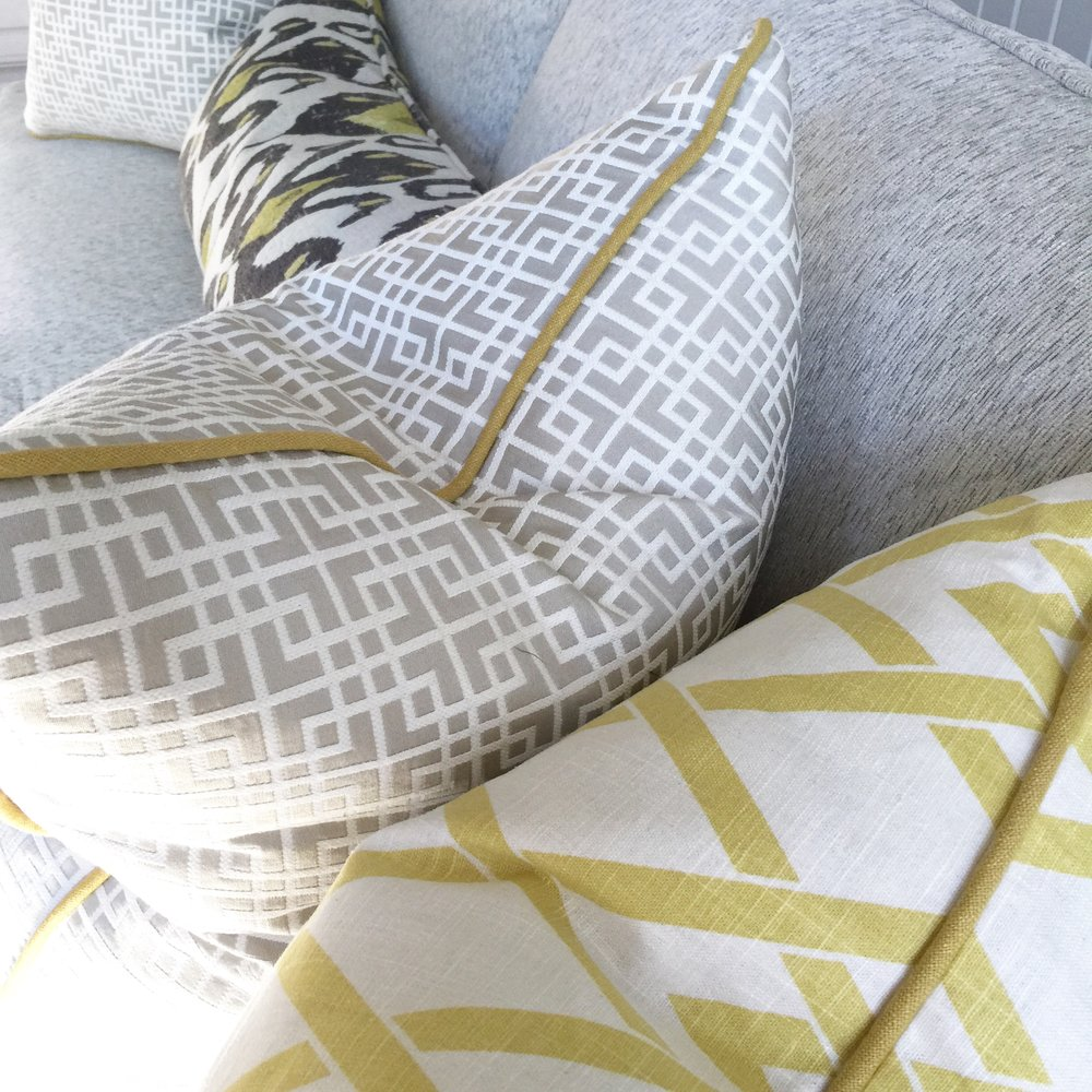 Gray and citrine custom pillows with welting - Designer: Carla Aston #pillows #sofapillows