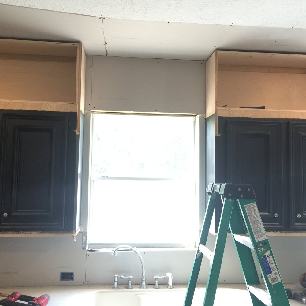 Progress Shot - Kitchen Remodel, view at window removing furr down and building cabinets to the ceiling