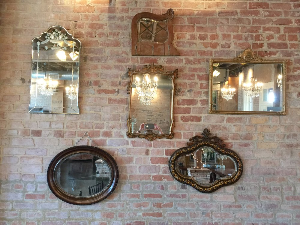 Exposed brick walls with antique mirrors.jpg