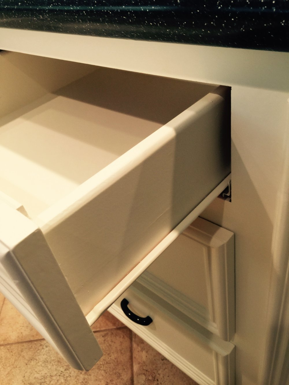 Standard drawer glides found in many builder homes.