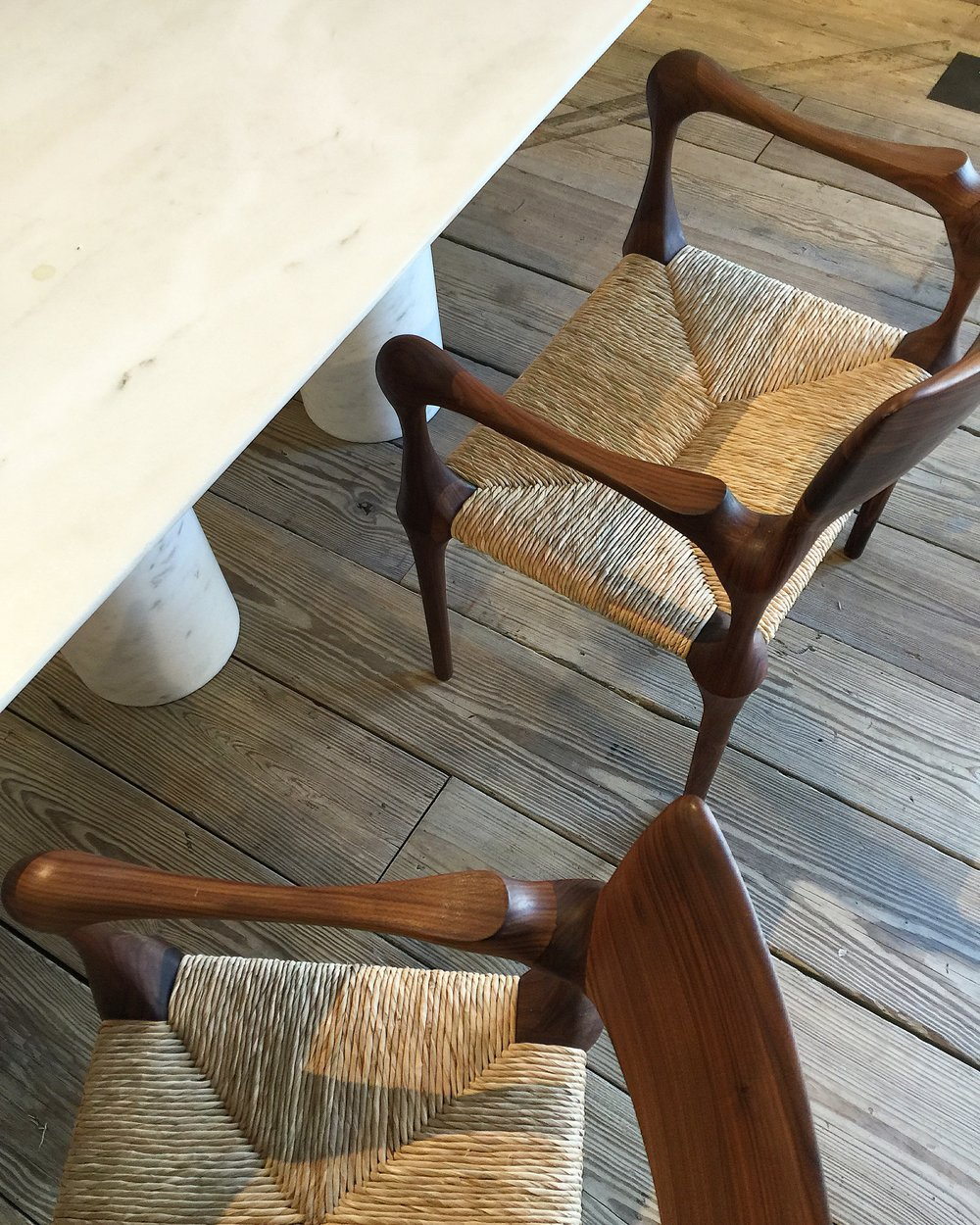 Knobby kneed walnut chairs with rush seats