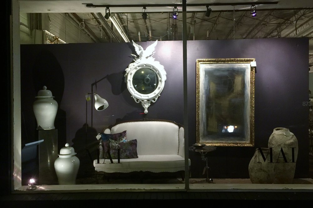 Night view of window display - MAI, Houston, windows designed by Carla Aston