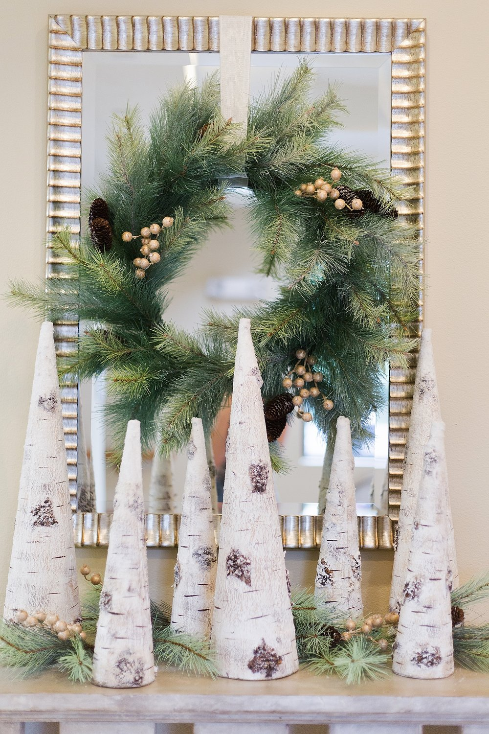 Woodlands Christmas decor on console from At Home decor store