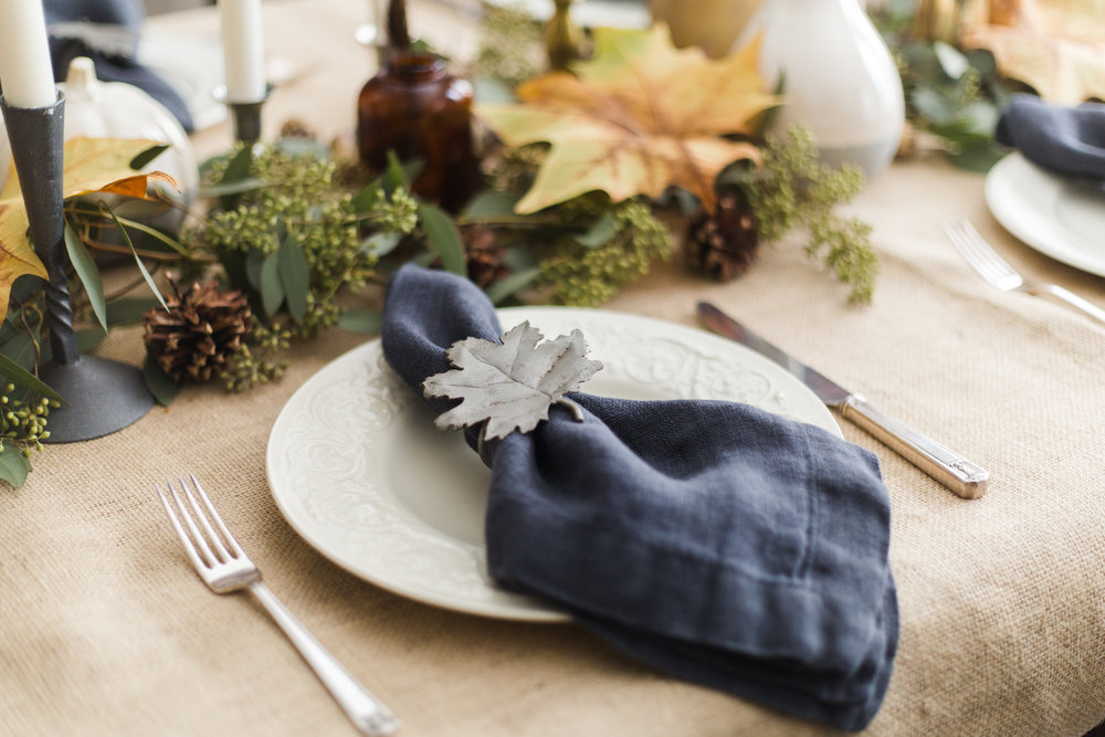 Thanksgiving / fall holiday tabletop decor with creamware, burlap, eucalyptus and fall leaves #falldecor #thanksgivingtablesetting #thanksgivingcenterpiece