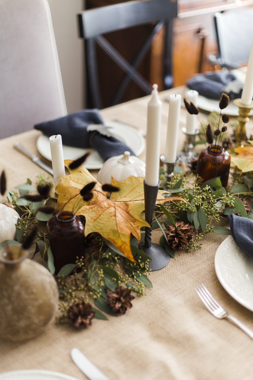 Thanksgiving / Fall Tabletop Decor w/ burlap tablecloth, creamware, pewter and brass candlesticks, eucalyptus and fall leaves / pumpkins from At Home stores