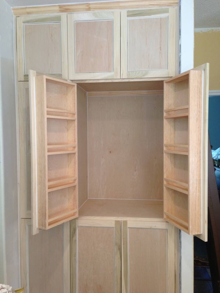 Spice racks built on backs of cabinet doors - custom cabinetry