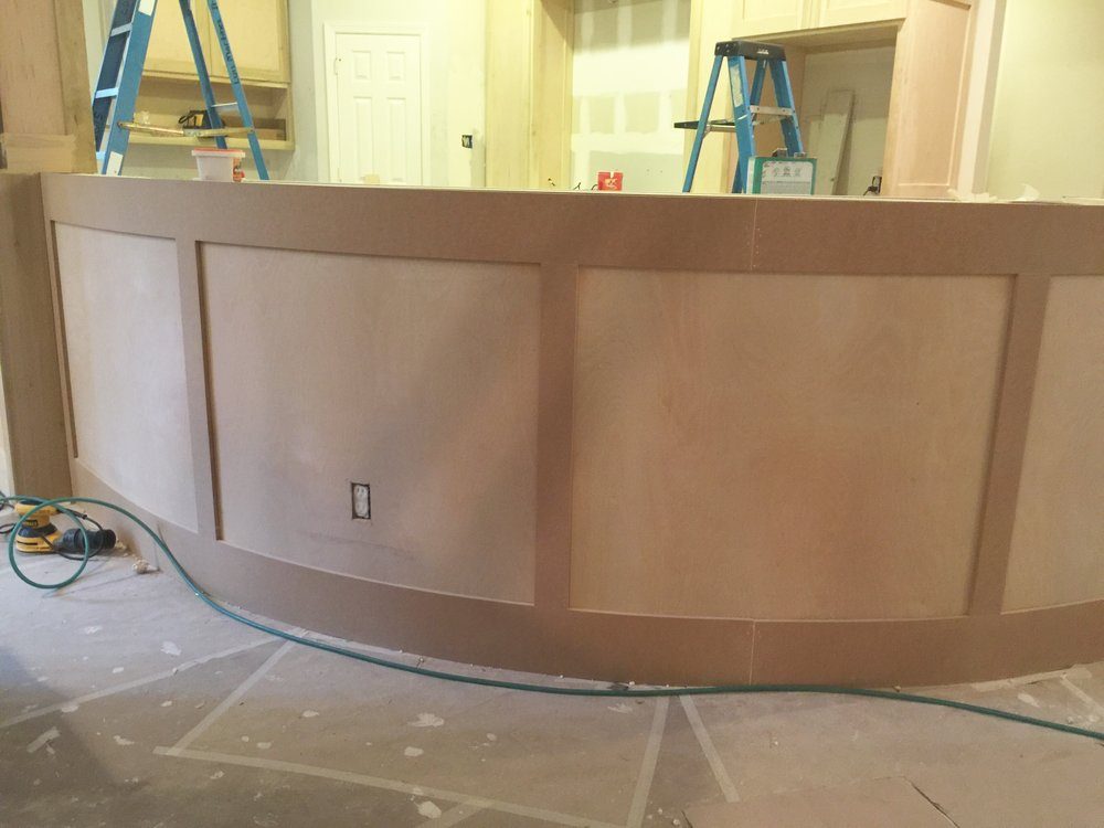 Paneled bar front and column will hold up much better to traffic and use over time.