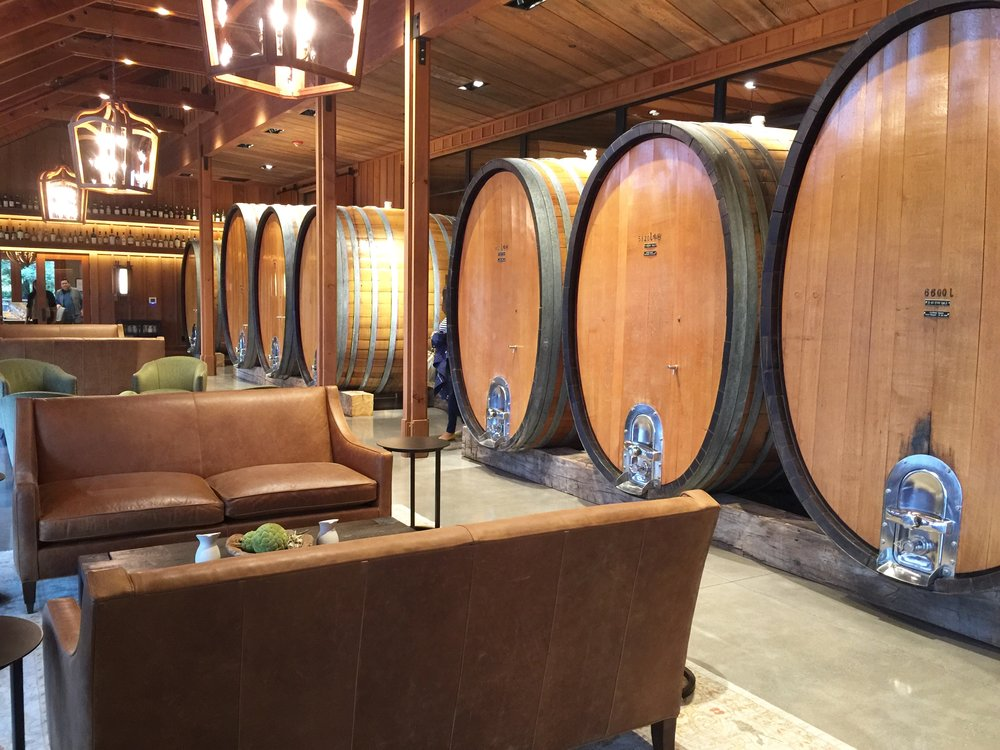 The Oval Room houses huge casks of wine with leather seating and more wood finishes.